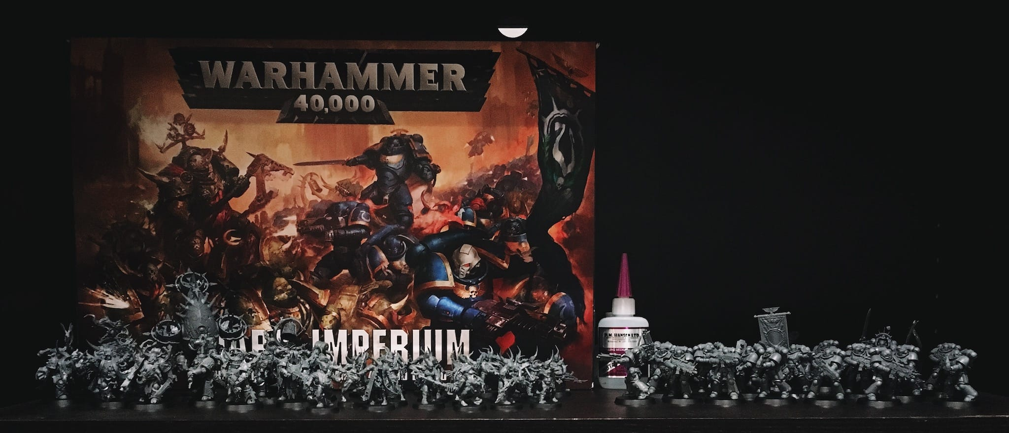 war hammer minis on bookshelf
